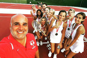 The Alton girls tennis team had a youthful lineup in 2021 with only two seniors on the team, Anna Kane and Amelia Redman. Alton High tennis coach Jesse Macias credits Kane and Redman with helping the younger players improve during the season. Above, Macias is shown with members of the team winning the Andy Simpson Doubles Tournament. Players, from front, include Scarlett Eades, Lauren Massey, Chloe Pugh, Anna Kane, Amelia Redman, Lydia Taul, Devora Newquist, Anna Brady, Ella Droste and Jamie Postlewait.