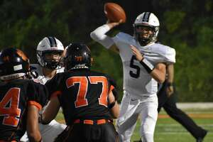 Xavier's Drew Kron throws a pass against Ridgefield during a football game at Maiolo Field, Ridgefield on Friday, Sept. 24, 2021.