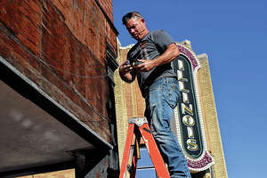 Mike Griffitts of Griffitts Construction works Monday on the side of a building in downtown Jacksonville.