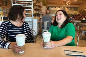 Amanda Beedle, 42, left, and Christine Napierski, 57, political newcomers, overcame differences and became friends on the campaign trail for Guilderland Town Board.