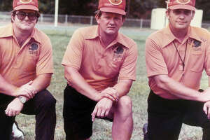 Former Edwardsville football coach Dick Ford, middle, with assistant coaches Tom Pile, left, and Ray Heinemeier.