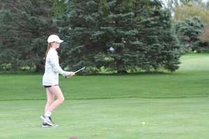 Manistee's Kendal Waligorski lines up her shot during a conference meet on Sept. 21.