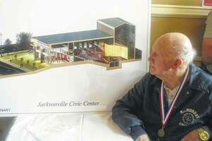 Ed Ecker looks at an architectural drawing of the planned Jacksonville Civic Center during an event in 2018.