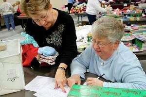 The Huron County Interfaith Council will be holding its Clothe-a-Child event again this year, which gives out full outfits to area kids in need. Last year 35 volunteers helped wrap and deliver clothes to 350 children. (Tribune File Photo)