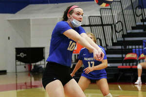 Marquette Catholic's Abby Williams, shown making a pass during a match at the Roxana Tourney in August, had a team-high 14 kills Monday in the Explorers' loss to the Kahoks in Collinsville.