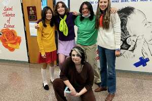"""Manistee Catholic Central freshmen dress as characters from """"Scooby-Doo"""" on Monday as part of the school's homecoming week celebration. (Courtesy photo)"""
