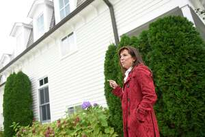 Neighborhood resident and HOA president Tabitha Young speaks outside her home in Greenwich, Conn. Monday, Oct. 18, 2021. Residents at 223-233 Milbank Ave. have been complaining of powerful blasting noises coming from the construction site nearby.