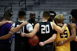 University at Albany menÕs basketball head coach Dwayne Killings talks to his players during practice on Tuesday, Oct. 19, 2021, at SEFCU Arena in Albany, N.Y.
