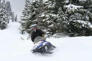 A snowmobiler in the backcountry of Mt. Baker, WA near Bellingham, WA.