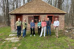 The Brick School in Warren. The Board of the Warren Connecticut Historical Society. From left, Craig Nelson, Heather Blue Forstmann, Marylyn Hendricks, Harriet Shapiro, Joanne Mansfield, Jon Garvey and John Favreau.