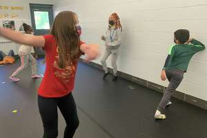 Wolfpit Elementary School dance teacher Karina Varele instructs her students to spin, using their arms to pull their bodies in a circle during class on Tuesday, Oct. 19.