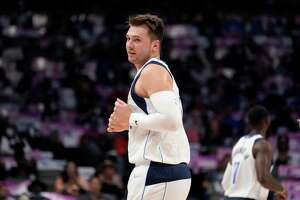Dallas Mavericks' Luka Doncic looks to the bench during a preseason NBA basketball game against the Los Angeles Clippers in Dallas, Friday, Oct. 8, 2021. (AP Photo/Tony Gutierrez)