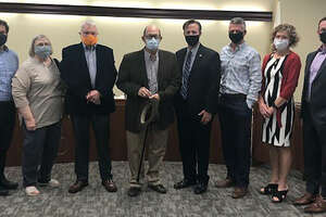 """Charles """"Skip"""" Schmidt, who served on the city's RASE Board for 14 years, was honored by the Edwardsville Mayor and City Council Tuesday during a city council meeting. Schmidt, center, is holding a hat and cane. From left are Alderman Chris Farrar, Alderwoman Janet Stack, Alderman Jack Burns, Mayor Art Risavy, Alderman SJ Morrison, Alderwoman Elizabeth Grant and Alderman William Krause."""