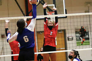 Staunton's Danielle Russell (2), shown putting up a block while Freeburg's Lindsey Muskopf (6) attacks during a Sept. 3 match at the Edwardsville Tourney, had seven kills in the Bulldog's SCC victory over Southwestern on Tuesday in Staunton.