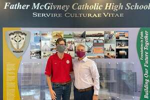 True Value Rental store in Edwardsville made a recent donation of health and safety kits to Father McGivney Catholic High School. Pictured is Alex St. Peters, left, of St. Peter's Hardware True Value Rental and Father McGivney principal Joe Lombardi.