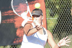 Edwardsville's Hannah Colbert hits a shot during her doubles match in the Edwardsville Sectional on Monday inside the EHS Tennis Center.