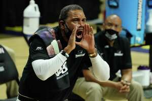 Providence coach Ed Cooley reacts the sideline in the first half against UConn in February.
