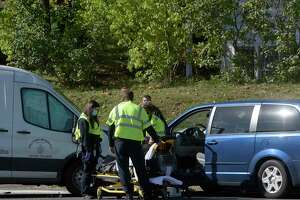 A woman was removed from her van by emergency services after being involved in a multi-vehicle accident on Danbury Road, Route 7, in New Milford, Conn, Wednesday morning, October 20, 2021.