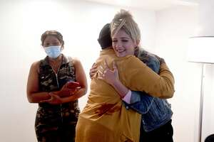 """Charrmayne Hadnot hugs make-up stylist Madison Sipes during """"Brave and Beautiful"""" - a make-over day for breast cancer patients and survivors at the Holiday Inn on Walden Road. Photo made Thursday, September 23, 2021 Kim Brent/The Enterprise"""