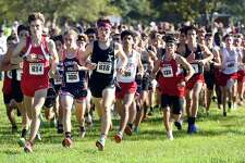 Eamon Burke (#618) of Xavier jumps to the front of the pack at the start of the Boys Varsity SCC XC Championship at East Shore Park in New Haven on October 20, 2021.