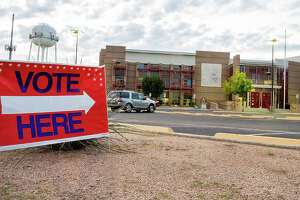 A Vote Here sign is seen outside the Laredo Fire Department Adminsitration building, Wednesday, Oct. 20, 2021.