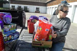 Tia Kephart of WJIL-WJVO unloads candy Wednesday at Prairie Land Heritage Museum in preparation for Safe Halloween, which will be from 4 to 6 p.m. today on the museum grounds.