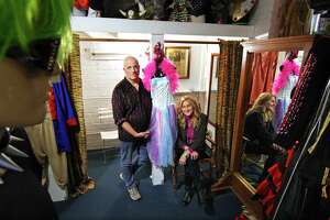 Sophia's Costume manager Glenn Beyus and owner Sophia Scarpelli, pose together at the shop in Greenwich, Conn., on Wednesday October 20, 2021. Sophia's Costume celebrated its 40th anniversary this year, but the building which once housed the New York Sports Club, and her store, is being redeveloped. It may force the popular costume destination to close it doors in the near future.