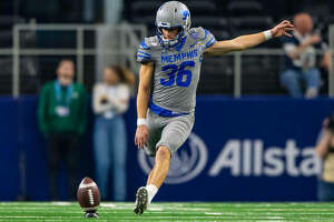 Riley Patterson kicks off during a game with the Memphis Tigers during his senior season.