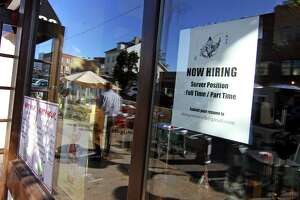 A help-wanted sign at a Greenwich, Conn. restaurant, on Oct. 20, 2021.