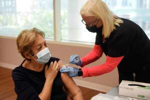 Linda Ilse, RN, administers a COVID-19 booster shot to Stamford's Pamela Koutroubis at the COVID booster clinic at the Senior Center in Stamford, Conn. Wednesday, Oct. 20, 2021. Dozens of seniors received a booster shot at Wednesday's clinic. The FDA has approved authorization for a single booster dose to be administered at least six months after completion of the primary series for individuals 65 years of age and older, individuals with certain high risk health factors, and individuals whose institutional or occupational exposure puts them at a higher risk of contracting the virus.
