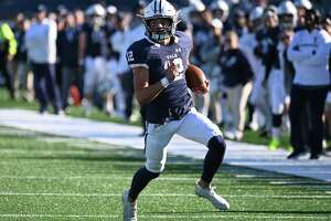 NEW HAVEN, CT - NOVEMBER 02: Yale Bulldogs quarterback Nolan Grooms (12) rushes down the field during the game as the Columbia Lions take on the Yale Bulldogs on November 2, 2019, at Yale Bowl.