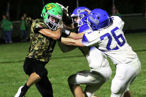 Southwestern's Collin Robinson (left) holds onto a touchdown catch contested by Greenville defenders Davin Johnson (26) and Landen Moss during a SCC game Sept. 17 in Piasa. After a 4-0 start, four successive losses have the Piasa Birds at 4-4 and needing a win Friday at Gillespie to make the playoffs.