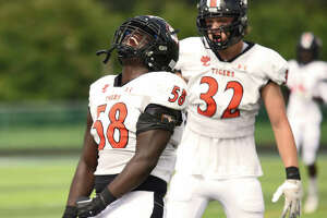 Edwardsville's Nasim Cairo is fired up after getting a sack against Belleville East.