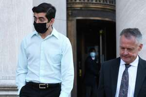 Connecticut State Rep. Michael DiMassa (left) leaves the federal courthouse in New Haven with his attorney, John Gulash, following his arrest on one count of wire fraud on October 20, 2021.