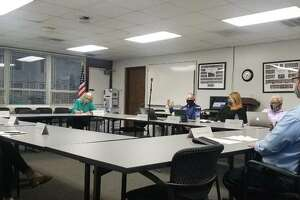 District 7 Citizens Advisory Council talks at its committee meeting Monday evening at the Hadley House in Edwardsville.