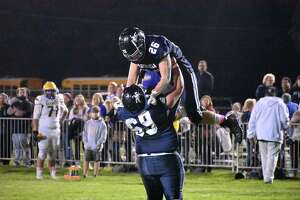 Ansonia's Preston Dziubina is lifted up after scoring a touchdown against Seymour at Nolan Field on Thursday.