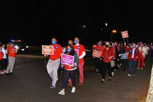 Educators, parents and students hold a march and rally to end attacks against teachers ahead of the Board of Education meeting at Central Middle School in Greenwich, Conn., on Thursday October 21, 2021. They are calling for an end to the increased attacks on teachers and the curriculum in the Greenwich Public Schools in recent months.