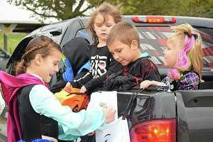 """Morgan County Junior Miss Lillie Brown — dressed as Princess Anna from """"Frozen"""" — hands out candy Thursday during Safe Halloween at Prairie Land Heritage Museum."""