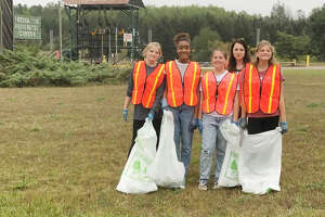 Members from Girl Scout Troop 4734 (from left) Bella Sorenson, Maya Goodspeed, Teagan Willard, Erin Pontiac, Bristol Sorenson collect bags of trash during a cleanup event this month.