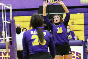 CM's Maddie Brueckner (3) sets while teammate Camryn Gehrs goes to the net during Tuesday's MVC match vs. Mascoutah in Bethalto. On Thursday in Jerseyville, Brueckner had a career-high 38 assists in the Eagles' win over Jersey.