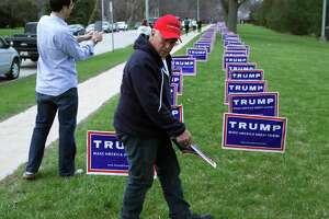 Yard signs for Republican presidential candidate Donald Trump outside a rally in 2016.