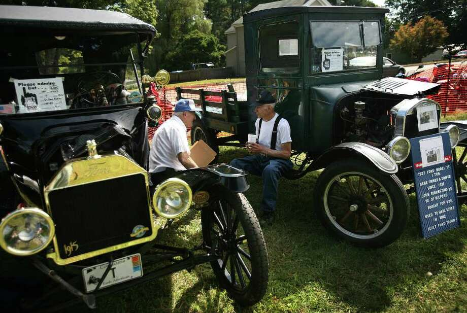 Ford Model T owners Anthony Fusco, left of Watertown, and John Sorrentino, Sr. of Milford, chat about their cars at the 40th Annual Roaring 20's Antique and Classic Car Show in Southbury on Sunday, September 19, 2010. The two men have owned their vehicles for a combined 132 years. Sorrentino celebrated his 93rd birthday on Sunday by driving his 1927 Ford Model T truck over two hours each way to get the show. Sorrentino purchased the truck when he was 21 years old for the sum of 20 dollars. Photo: Brian A. Pounds / Connecticut Post