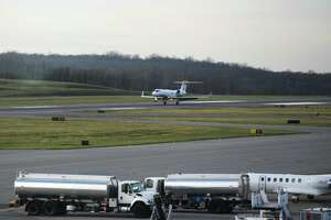 A plane touches down on the runway at the Westchester County Airport in White Plains, N.Y. Thursday, Nov. 19, 2020.