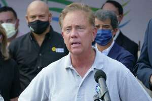 Gov. Ned Lamont speaks during a press conference outside the CTown grocery store on North Street in Danbury, Conn. Friday, Aug. 27, 2021. He will visit Danbury on Saturday to rally for local Democrats.