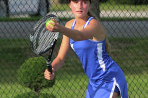Marquette's Monica Wendle advanced to the fifth round in the consolation bracket of the IHSA Girls State Tennis tournament, but then fell to Oak Park Fenwick's Kate Trifilio 6-3, 6-0 Friday in suburban Chicago.