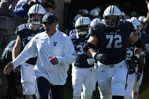 Yale coach Tony Reno and the Bulldogs take the field for a 2019 game against Columbia in New Haven.