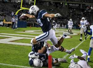 UConn tight end Brandon Niemenski (83) scores on an 8-yard touchdown reception against Middle Tennessee State during an NCAA football game on Friday, Oct. 22, 2021 in East Hartford, Conn.
