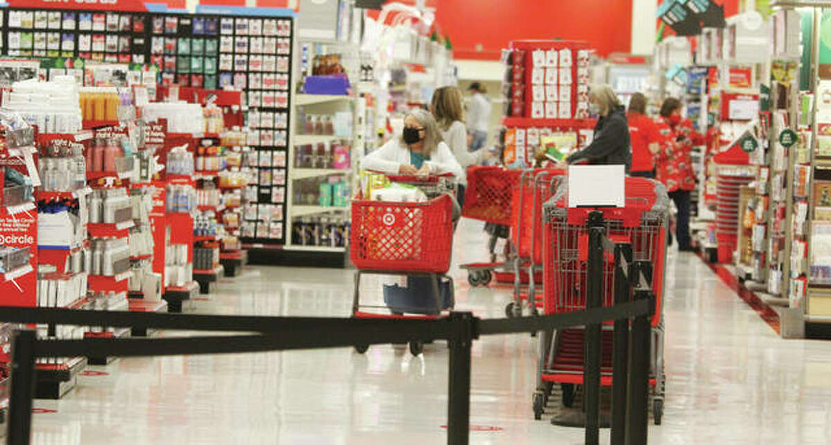 """A lone shopper heads toward the checkout at the Alton Target store during Black Friday last year. Black Friday, the traditional start to the holiday shopping season, saw far fewer people hitting the stores because of the coronavirus pandemic. But that was, in part, by design, as stores have emphasized online sales, and also spread out """"Black Friday"""" sales through the entire month of November."""