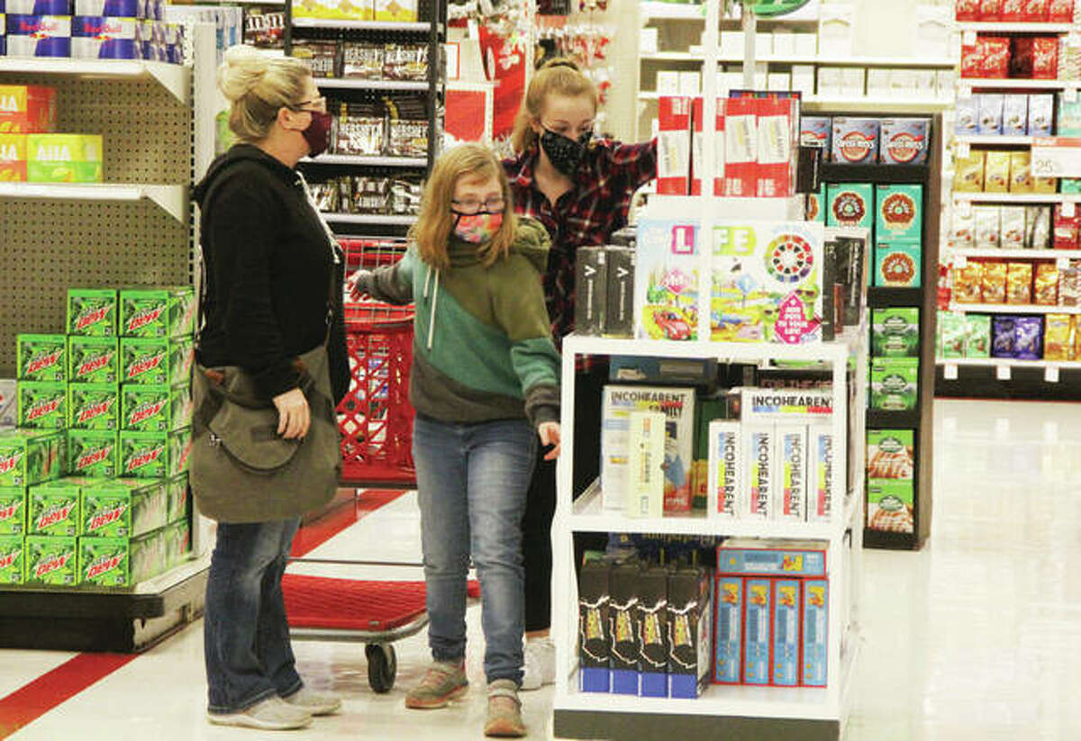 Amber Wilson, left, and daughters Lucy, then 11, and Lily, then 16, look over items in the Alton Target store during last year's Black Friday sales. Black Friday, the traditional start to the holiday shopping season, saw far fewer people hitting the stores because of the coronavirus pandemic. Many stores, including Target, plan to be closed on Thanksgiving.