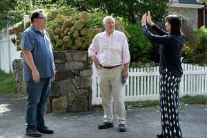 William Kelly, center, the Democratic candidate for first selectman in Greenwich, chats with Joe Gross, left, and Gerri Flemming, right, during a campaign walk Saturday, Oct. 16, 2021.